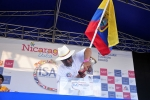 "Team Ecuador pouring sand at the ""Sands of the Worlds"" ceremony. Credt: ISA / Rommel Gonzales"